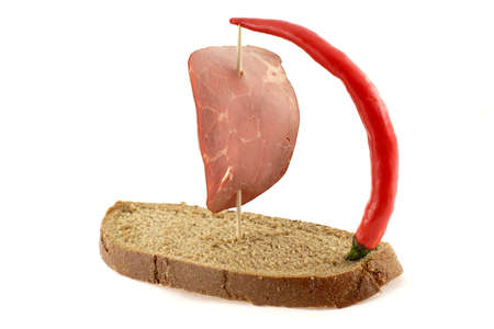 Ship made of bread with sail made of ham and pepper