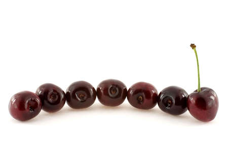 Seven cherries forming a curve