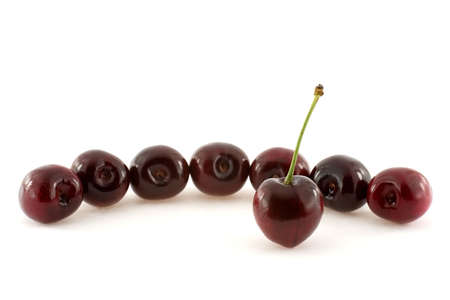 Eight cherries over white background