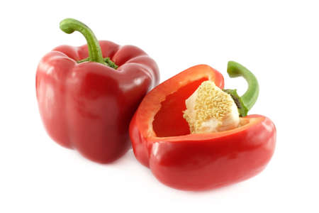 Red sweet peppers over white background photo