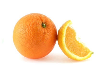 Whole orange with a slice over white background