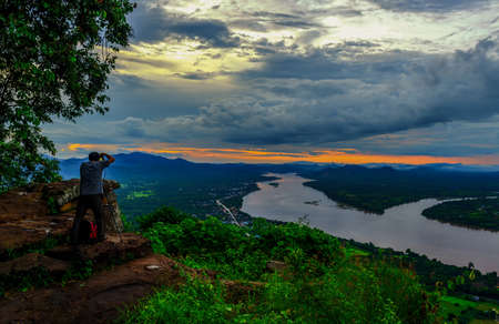 behind scenes: Tourists taking photos of Mekong River Landscape in nongkhai,ThaiLand Stock Photo