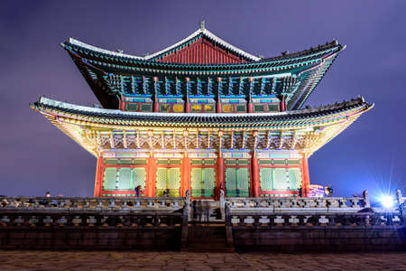 Gyeongbokgung Palace At Night In South Korea, with the name of the palace Gyeongbokgung on a sign
