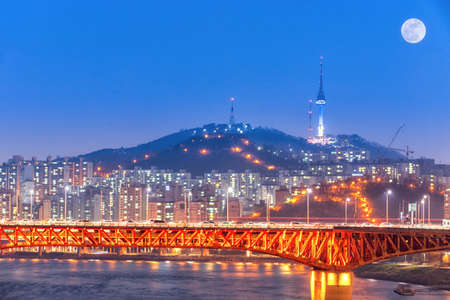 landscape of Hangung River in the evening and Seoul Tower in the night in Seoul, Korea
