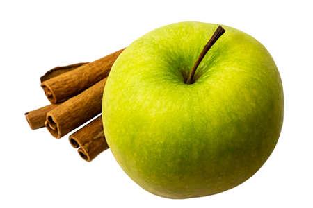 Green apple with cinnamon sticks close up Standard-Bild
