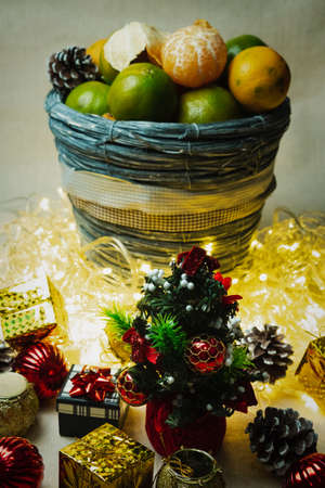 Christmas Festive Decoration Set With a Small Christmas Tree and Tangerines. Still Life