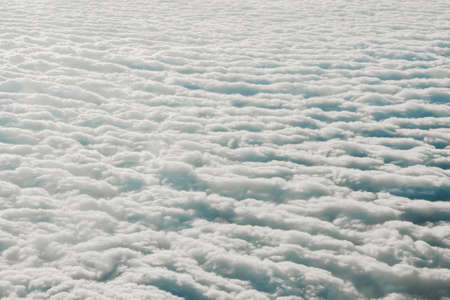 Sky cloudy overcast. Clouds texture background. View on white clouds from above. View from airplane. Layer of clouds top view