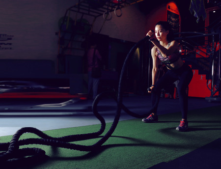 beauties: Fitness woman in Gym room Editorial