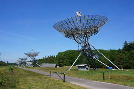 The Westerbork Synthesis Radio Telescope in the Netherlands WSRT consists of 14 dish-shaped antennas. Stock Photo