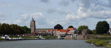 The harbor of Gorinchem with the church in the background. Editorial
