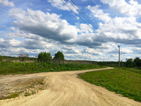 Nature. Cumulus clouds. Meadow. Dirt road