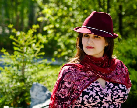 bordo: Women in bordo hat on the park