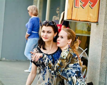 Two young women talks about sales and shopping photo