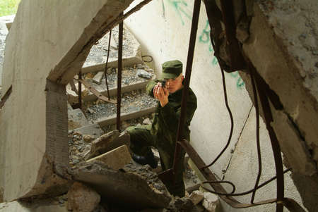The soldier with a pistol performs antiterrorist operation. photo