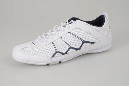 white trainer shoes isolated photo