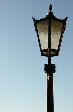 Historic street light against a blue sky