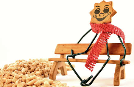 Close-up of a figure on a wooden bench with wood pellets