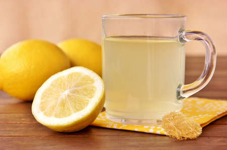 hot lemon tea  with fresh lemons photo