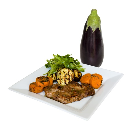 Grilled eggplant and meat, sweet potatoes and salad photo