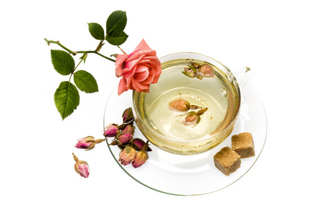 Fragrant and tasty tea made of dried rose buds photo