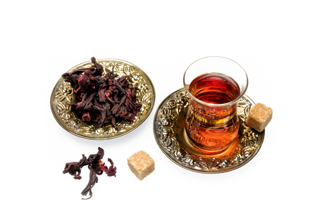 Fragrant and tasty tea from dried hibiscus flowers photo