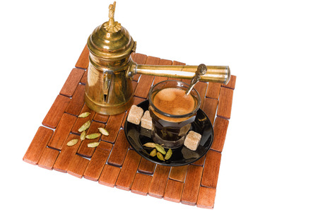 Traditional Turkish coffee served with coriander seeds photo