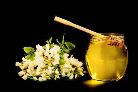 Pure acacia honey is very popular and coveted. photo