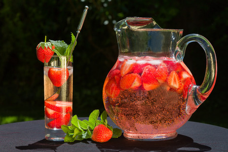 Strawberry drink with sect is wonderful summer refreshment. photo