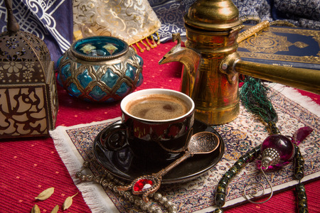 Traditional Arabic coffee served with cardamom seeds photo