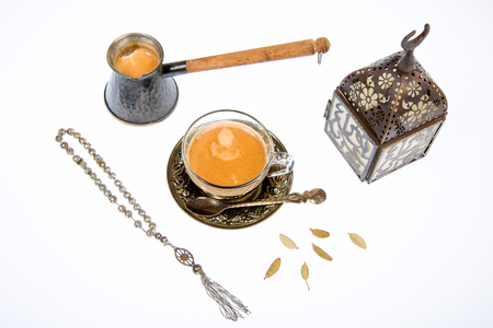 Arabic coffee with cardamon on a white background photo