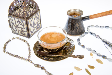 arabic coffee: Arabic coffee with cardamon on a white background