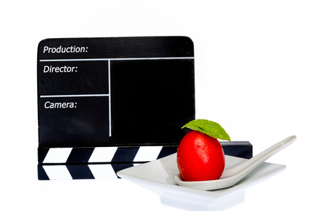 filmmaker: Tomatoes Story - tomatoes and film flap on stage