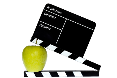 flap: Green apple and film flap - white background Stock Photo