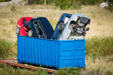 wrecked: Wrecked cars stacked in a blue container