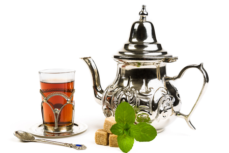 teapot: Traditional Arabic mint tea on white backgroun