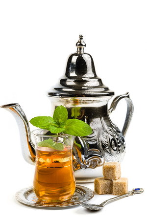 Traditional Arabic mint tea on white background Stock Photo