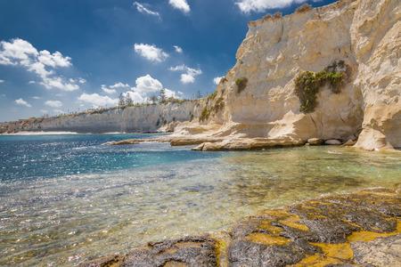 Rocky beach in Marsaskala bay on the coast of the island Malta in the Mediterranean sea. Stock Photo