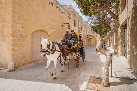 presidency: Mdina, Malta - May 04 2016: City tour in a stylish carriage - Mdina, Malta - Old Capital and the Silent City of Malta - Medieval Town Editorial