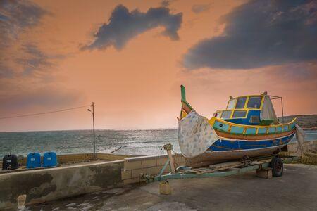 Boat at the fishing port near Marsaskala on the Malta island Stock Photo