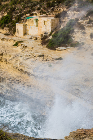 Powerful sea surf on the rocky coast of Il-Kalanka Bay on the island of Malta.