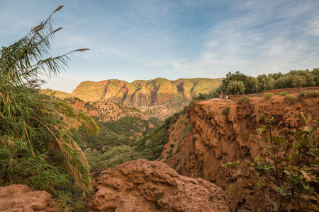 The land around waterfalls Ozoud in Morocco is characterized by red rock.