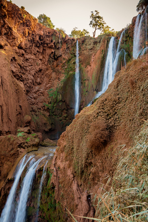 frequented: Ouzoud waterfalls in the Atlas Mountains in Morocco are often frequented by tourists attraction.