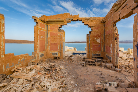 reservoirs: Ruins of a house on the shore Water reservoirs El Mansour Eddahbi in Morocco Stock Photo