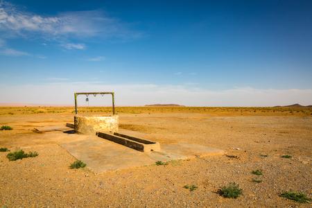 reg: Waterhole for camel caravans in the Reg desert Sahara, Morocco