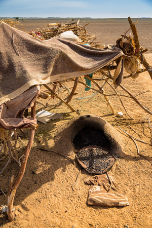 Traditional nomadic shelter with a stove on Arabic bread. Photographed on the edge of the Sahara desert in Morocco.
