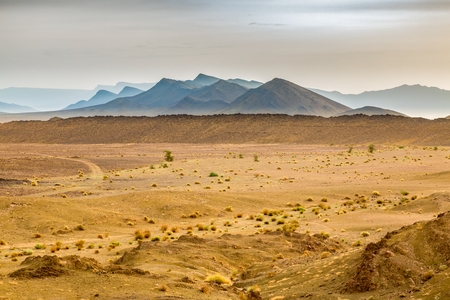 Landscape of southern Morocco is characterized by mountains, plains, stony soil, sand and meager vegetation.