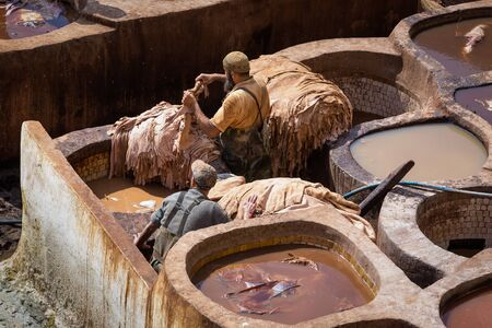 fes: Fes, Morocco - February 28, 2017: Traditional processing leather tannery in Fes, Morocco