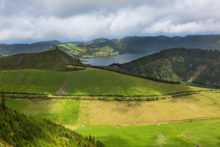 portugal agriculture: Blue and green lake in the volcano craters of the island of Sao Miguel, part of the Azores. Stock Photo