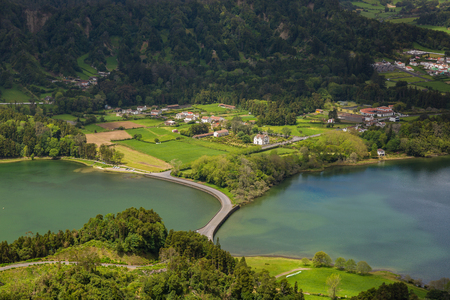 crater lake: Blue and green lake in the volcano craters of the island of Sao Miguel, part of the Azores. Stock Photo