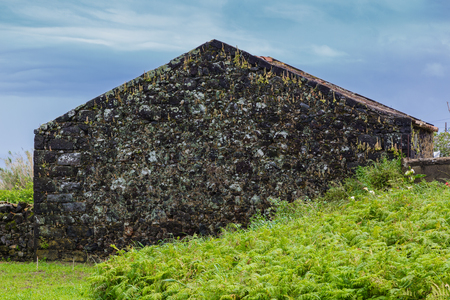 Abandoned building on the northern coast of Sao Miguel island, archipelago of the Azores in the Atlantic Ocean belonging to Portugal Stock Photo